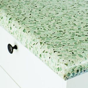 I love recycled glass counter tops... I'm not a totally sold on this particular one.  I would want one with yellow tones or more blue tones.
