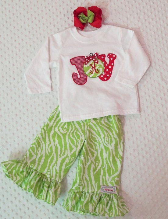 Girls Christmas outfit with ruffle pants and matching appliqued shirt with monogram in the ornament. $40.00, via Etsy.