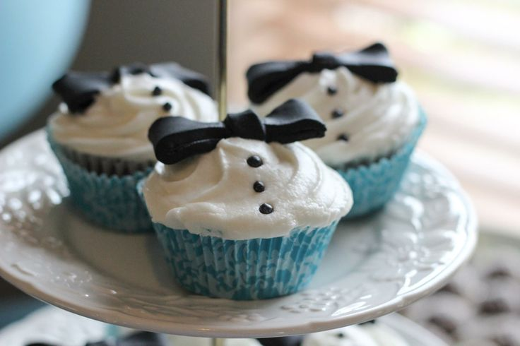 Little Gentleman and Bowtie inspired 1st Birthday party I did for my son Milo. Tired of all the mustache out there. Bowtie tuxedo cupcakes.