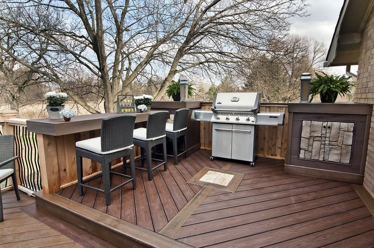 """A barbeque nook with side tables a built in cabinet, and a large dry bar perfect for serving food or enjoying the view. From """"Decked Out"""" project """"The Whole Family Deck"""". Deck Design by Paul Lafrance Design."""