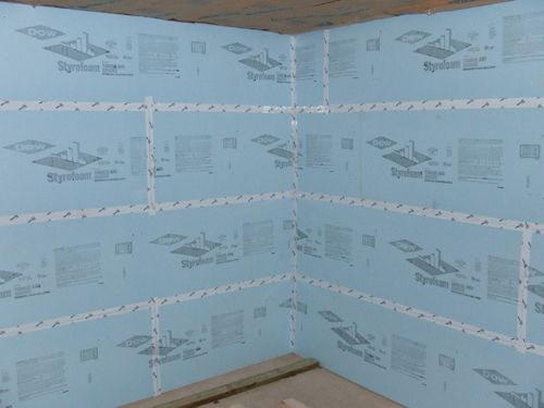 Insulate your basement with foam board. NEVER use fiberglass. Includes information on insulating floors, too.