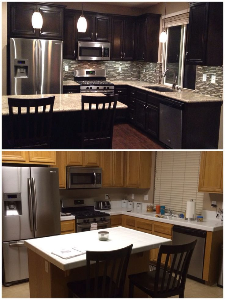 Upgraded kitchen. Espresso dark stained cabinets. Added hardware. Glass mosaic backsplash. Granite countertops. Laminate flooring. Added drop lights. Black granite sink.