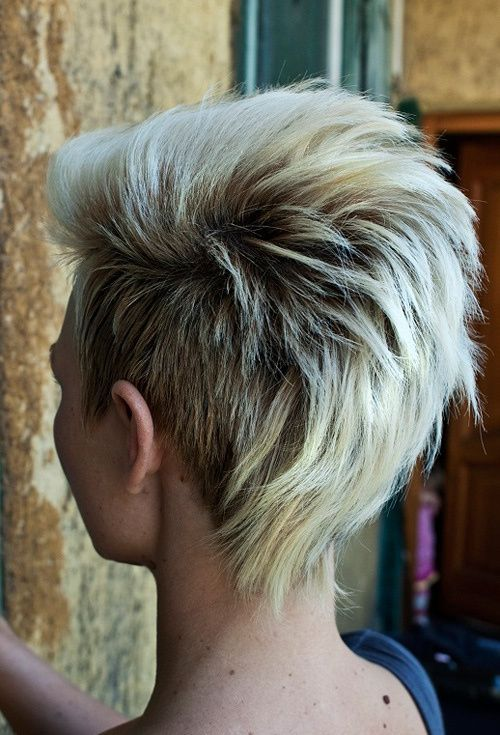 Short mohawk-inspired haircut. If you want to make your short cut a bit more daring, have the sides shortened in the spirit of challenging punk hairstyles. The two measuring contrasting textures look very showy, especially after you place coloristic accents.