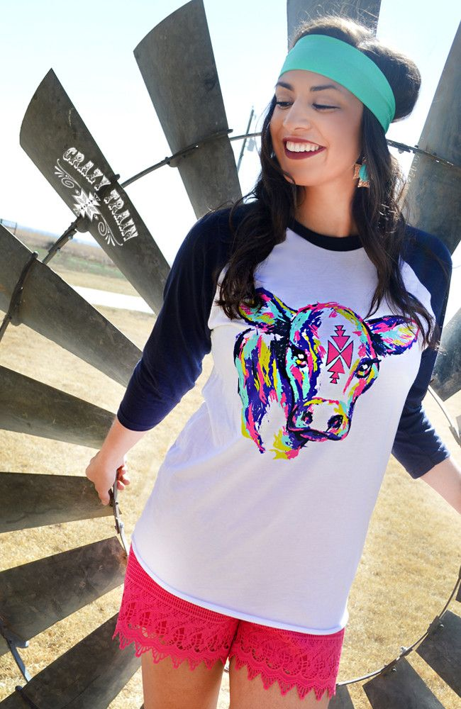 We're lovin' this new line from Crazy Train! Jump on board with our 'Neon Young Gun' Baseball Tee Shirt with a colorful neon up and comer on the front, and black sleeves. Show time, anyone? Perfect fo