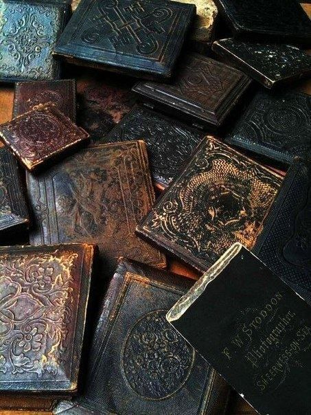 Look at all the gorgeous detail on these old books! I love them.                                                                                                                                                     More