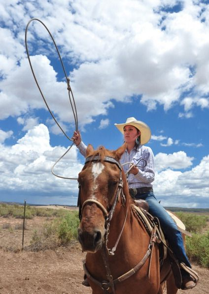 A rodeo cowgirl practices her roping techniques before competing in the steer roping contest at the annual Rodeo de Galisteo in Galisteo a small town...
