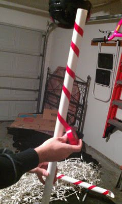 Candy Cane Lane - pvc pipes, red electrical tape. Once made, you can use as a border and string lights across them for 'Peppermint Forest'