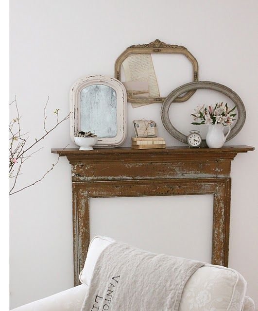 Shabby chic fireplace plus mirrors