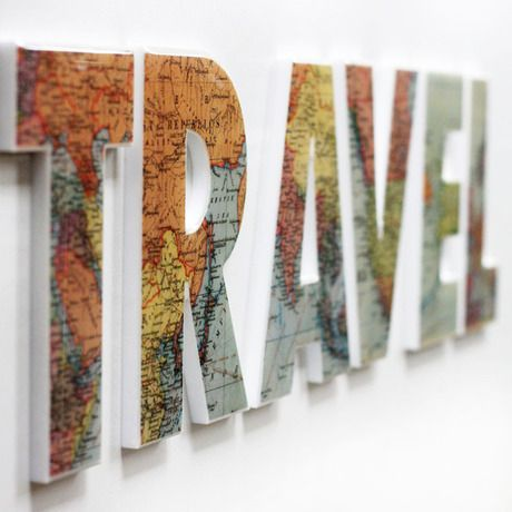 Cover TRAVEL letters with maps, then surround with photos of family on various trips.