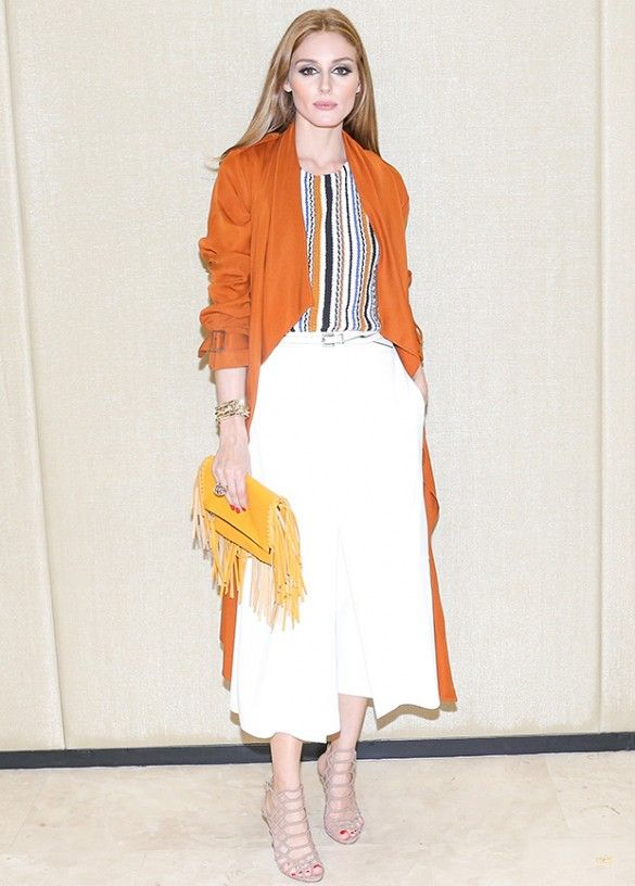Olivia Palermo matches her Zara top with an orange trench, yellow clutch and white culottes