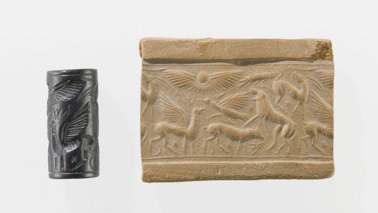 Combat d'animaux et signes d'écriture chypro-minoenne  Bronze récent (XIVe siècle avant J.-C.)  Chypre Hématite  Acquisition 1915 Département des Antiquités orientales AM 1669
