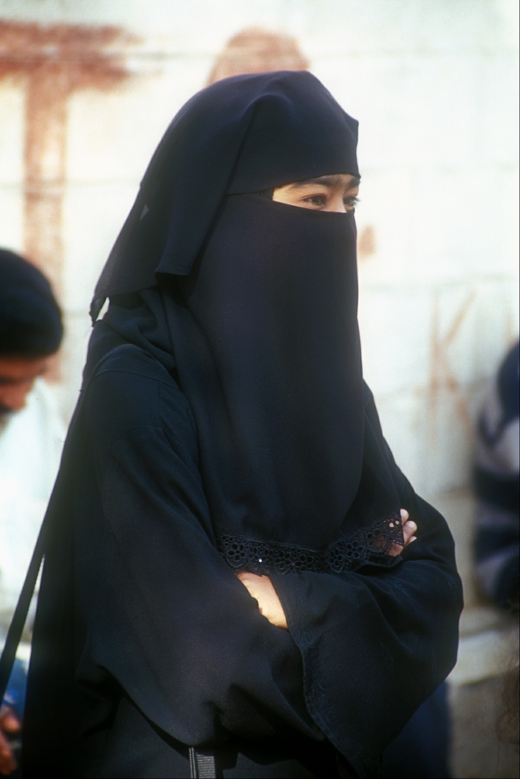 Smiling eyes in a burqa.