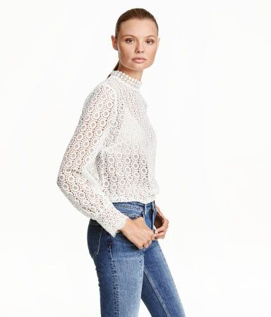 White. Lace blouse with a stand-up collar with buttons at back and long sleeves with wide cuffs. H&M $50