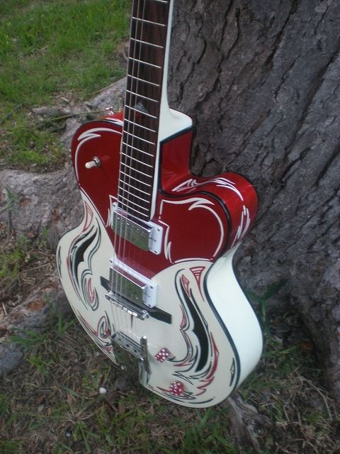 Hollow-body guitar with customer 2 tone paint and pinstriping