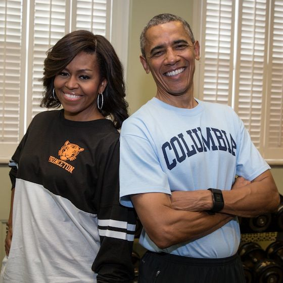 First Lady Michelle Obama and President Obama wear their college gear for…