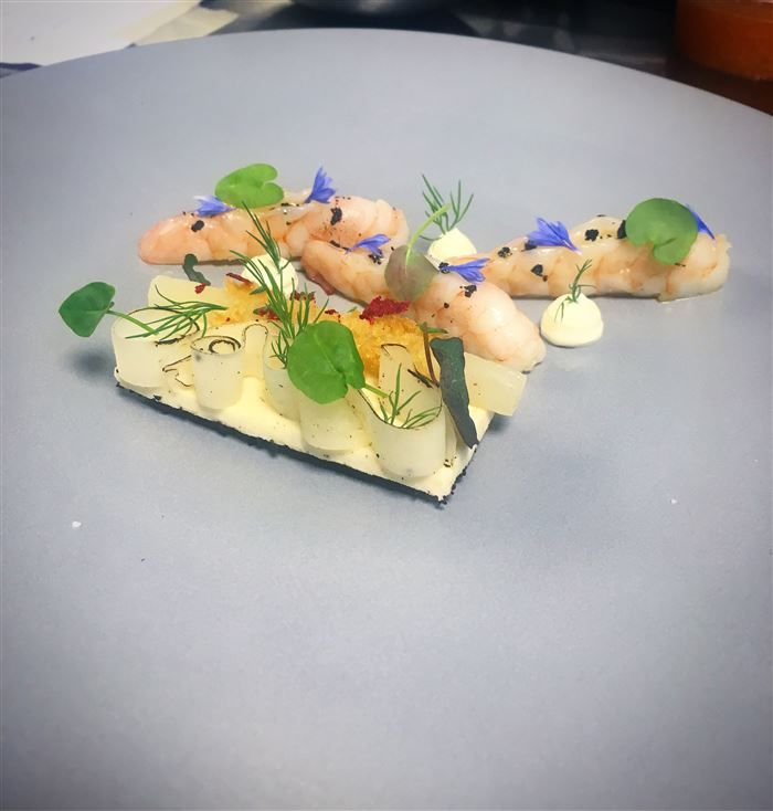 """Tigerprawns poached with beurre monte, salsify in """"flan"""", pickled and fritted, dehydrated kalamata-olives and finnish sour creme."""
