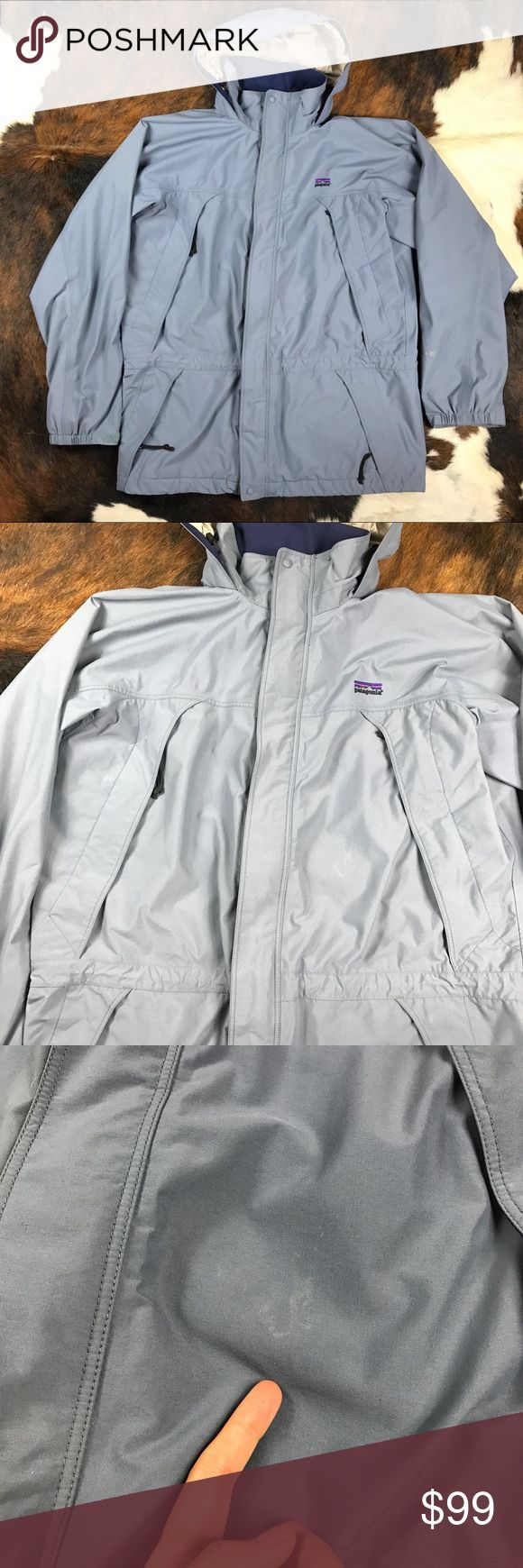 Patagonia Liquid Sky Gore Tex Rain Jacket Patagonia Liquid Sky Mens Larg Gore Tex Hood Long Full Zip Shell Rain Jacket  Just a few signs of wear(see pictures) , nothing major. Overall Great condition, just washed jacket. From smoke free home.  Measurements (approx): pit to pit: 26 inches,  shoulder to bottom: 32.5 inches, sleeve: 26 inches Patagonia Jackets & Coats Raincoats