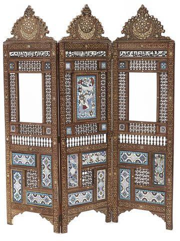 An Islamic enamel and carved wood three fold floor screen