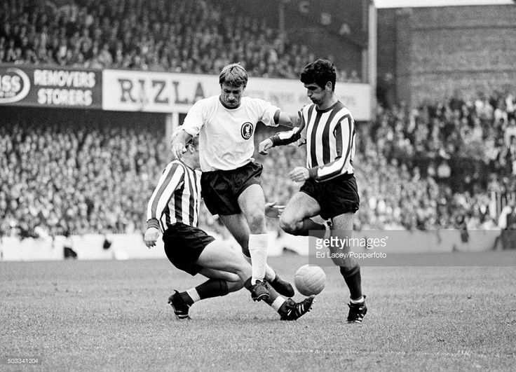 Liverpool striker Roger Hunt (white shirt) forces his way past Southampton defenders Jimmy Gabriel and Hugh Fisher (right) during their match at The Dell, in Southampton, 16th September 1967.