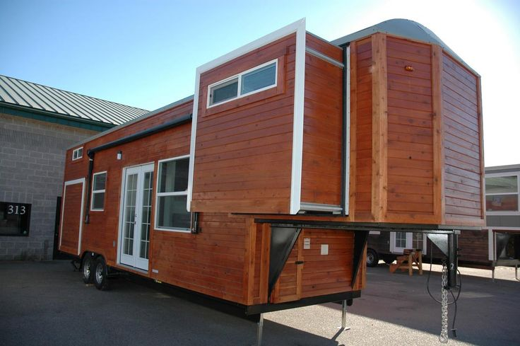 A 35' long, 320 sq.ft. gooseneck tiny house with 3 slide outs. Sleeps 8 people between the front Murphy bed, rear bedroom, and bedroom loft.