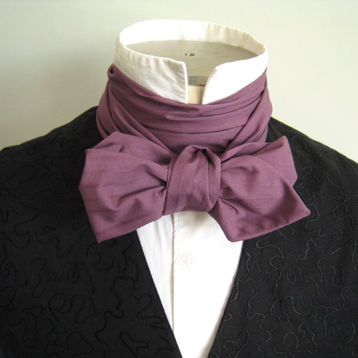 There are many ways a Victorian gentleman may choose to tie his neckwear. Here is one of the simpler knots, illustrated that you may practice at home. We have made a special cravat for demonstration