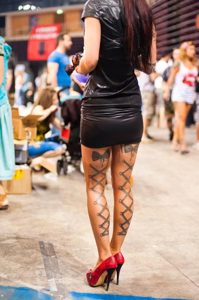 Hot! <3 these back of the legs lace up corset and bow tattoos! BTW - shes wearing a hot pair of iron fist shoes ( I own them in purple) :)