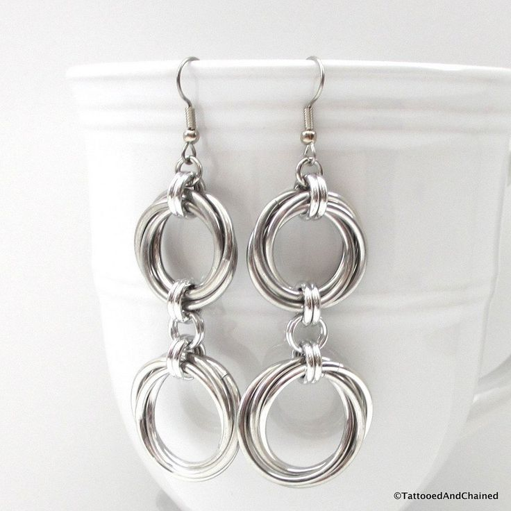 Make a statement wearing these bold chainmaille earrings! Large, thick 14 gauge silver aluminum jump rings were möbiused together to create the swirl look of the double love knots. - Earring length: 3