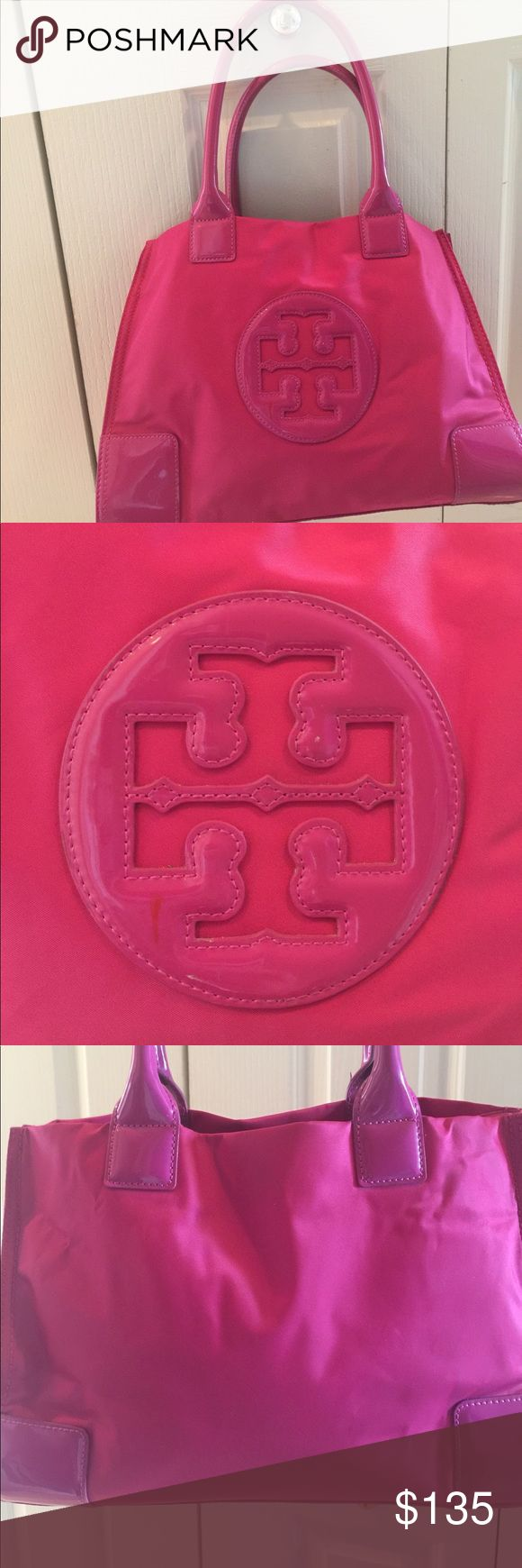 Tory Burch Ella Nylon tote Tory Burch colorblock nylon tote with faux-leather (PVC) trim. Rolled top handles, 7 drop. Open top. Logo applique at center. Snap sides expand bag. Interior, logo-jacquard lining; one zip and one slip pocket. 13H x 17W x 5D. Mine is very gently used.  No visible marks at all !! Buy at listed price or make an offer.  Bright pink tote goes with everything!!! Tory Burch Bags Totes