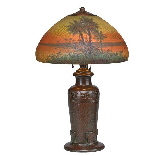 handel table lamp its glass shade obverse and reverse painted with palm trees meriden