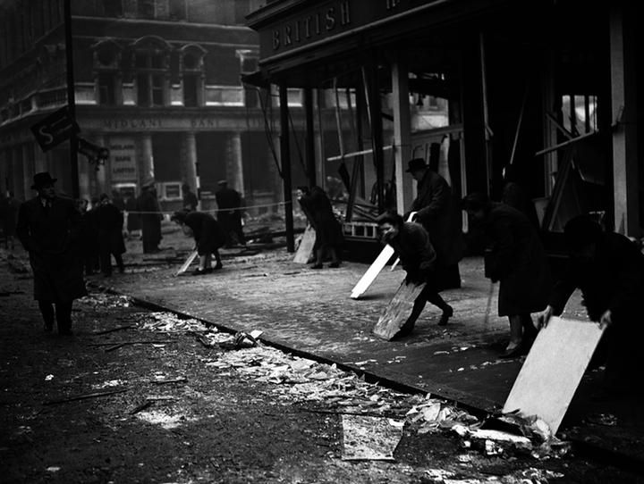 Clearing up; British Home Stores, Peckham, bombing 1943