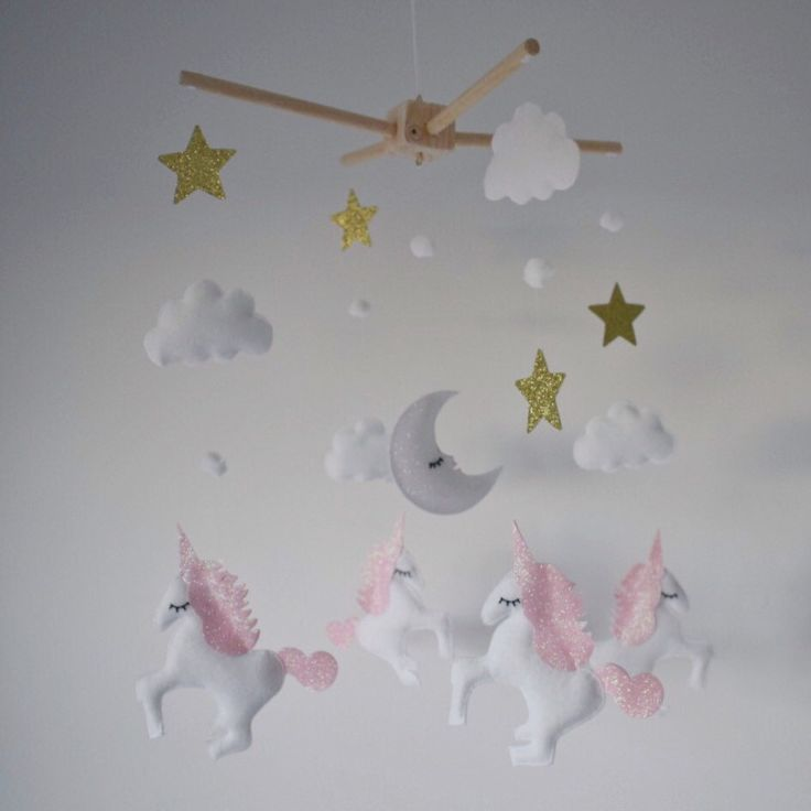 I love making these unicorn mobiles ⭐️⭐️   Pretty pink and gold glitter details for felt unicorns and stars on this handmade baby / crib mobile, with a pearlescent moon and white felt clouds.   A beautiful and magical addition to a baby's nursery room.