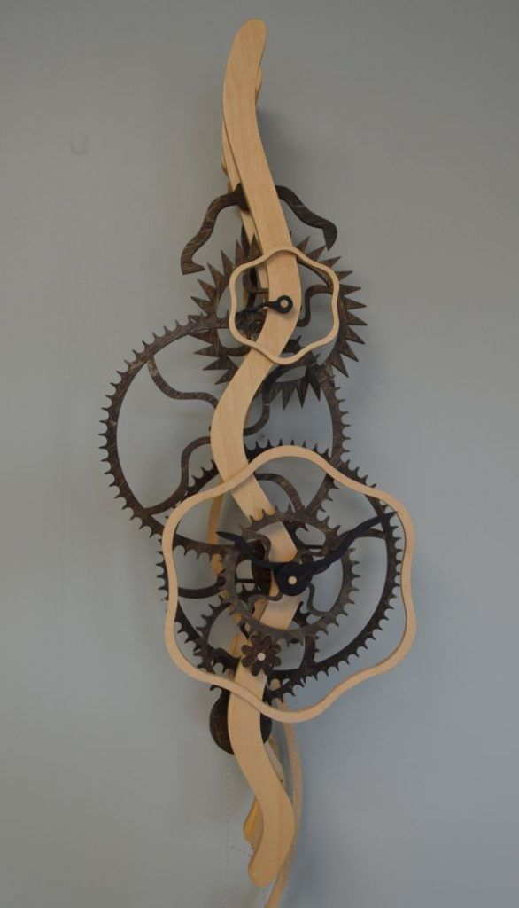 Wooden gear clocks, clock kits, and do-it-yourself clock plans. These original all-wood clocks are functional, attractive, and fun!