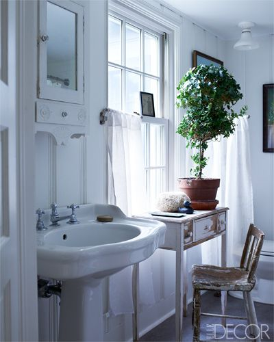 The table and chair in the guest bath are flea-market finds.