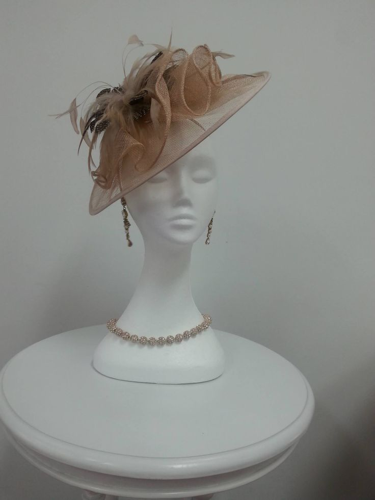 Gorgeous Hatinator with Feathers and tule bow Soft Apricot