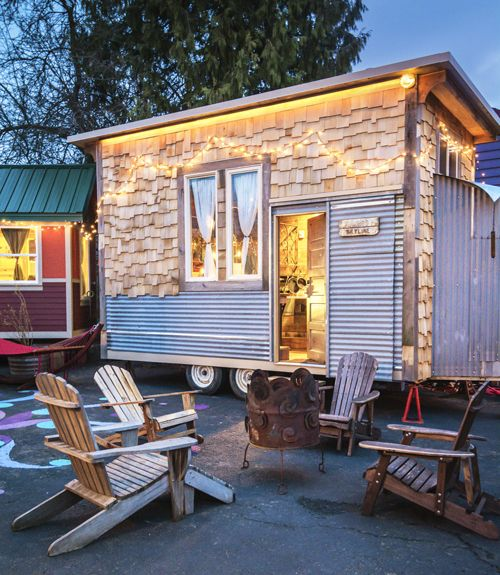 One of six tiny houses—each built on wheels and outfitted with a bathroom, kitchen, and sleeping loft — at Caravan — The Tiny House Hotel in Portland, Oregon, the Skyline cabin is one of the newest additions to the hotel. The 160-square-foot structure is constructed of mostly salvaged materials and houses two queen beds. Rental rates are $125 per night. Look inside the Skyline.   - HouseBeautiful.com