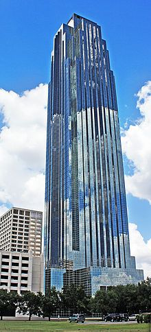 Tall, symmetrical,  glass skyscraper with triangular peak, and setbacks that narrow the building as it rises.  A chevron design under the top seems to be pushed upward by  a long, thin arrow. This post modern building is known as the Williams Tower and is located at 2800 Post Oak BLVD and was created by Phillip Joshnson and John Burgee