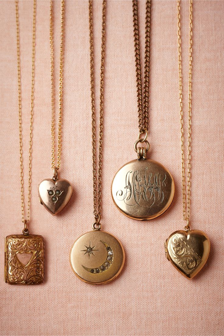 The locket in the middle with the moon and star looks like a bracelet my grandma had. Lovely. Collectors Lockets from BHLDN