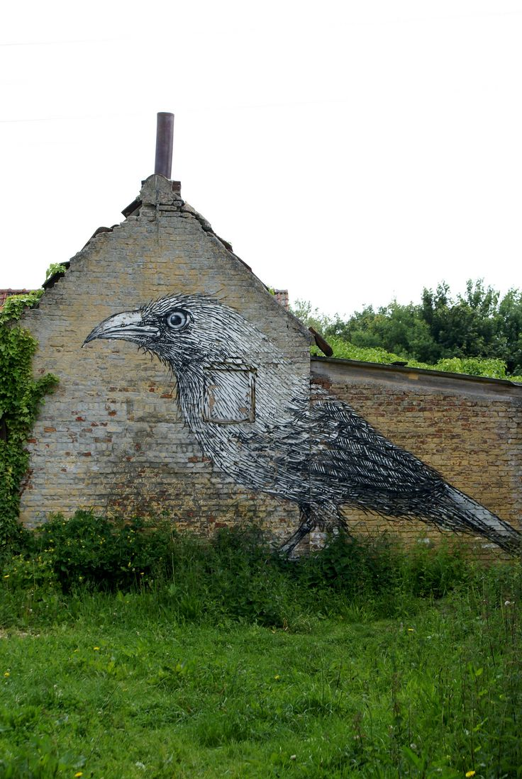 Old stone cottage with crow art