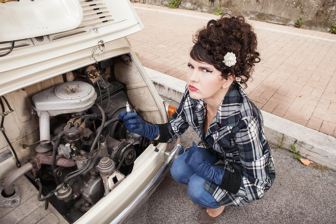 clueless woman with broken down fiat 600