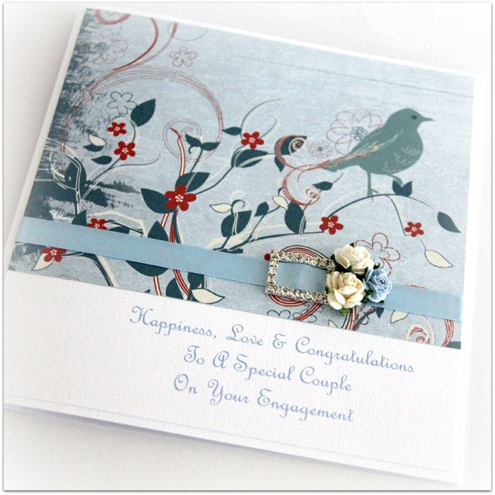 A beautifully made blue bird engagement card that will be a keepsake for always.