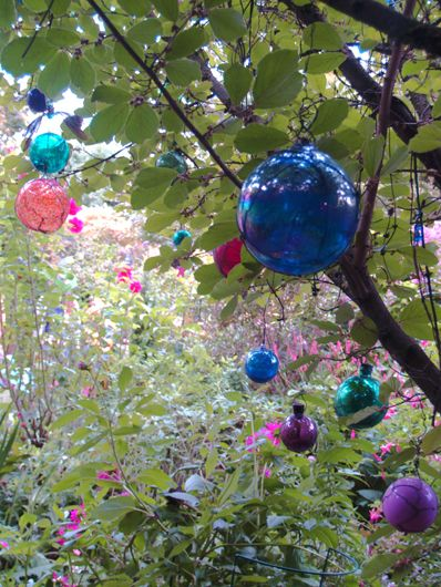 Lo: This would be a good idea for the trees outside. I can also hang them from the fabric filled with lights so they give off a multi colored glow