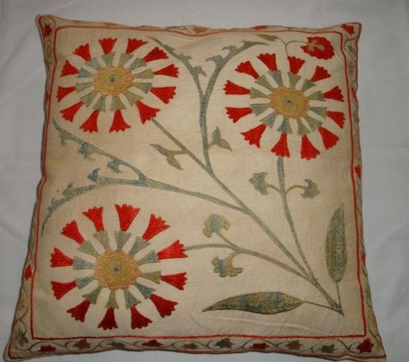 Suzani motifs on a modern pillow cover