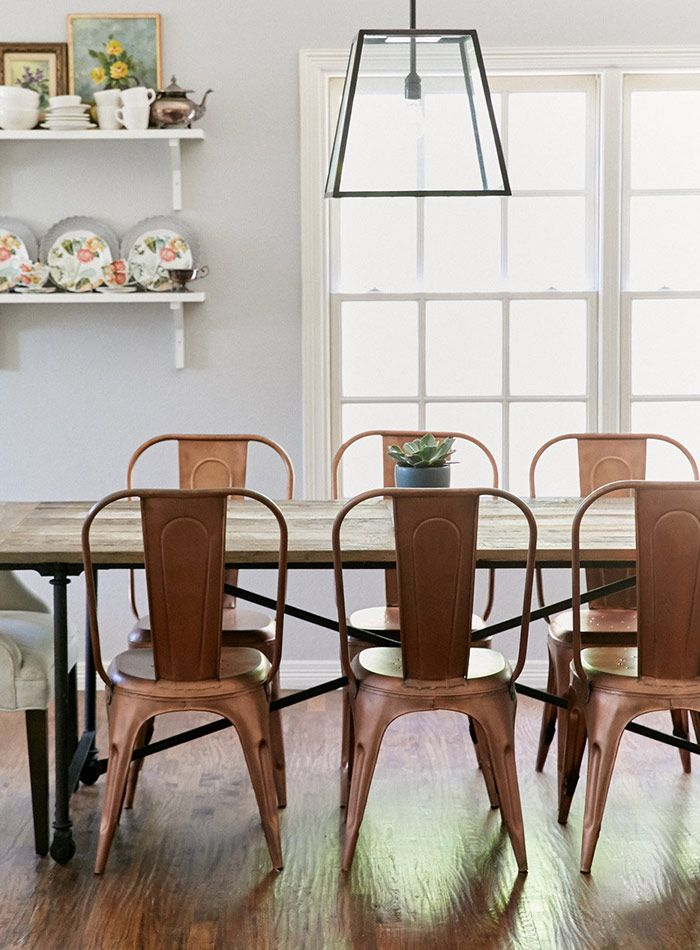 The raw-wood Restoration Hardware Outlet table has had paint, many dinners and wax spilled on it. That messy history is exactly what the couple loves about it. The copper Anthropologie chairs were a steal on Craigslist. Light fixture by Restoration Hardware Outlet. | Design*Sponge