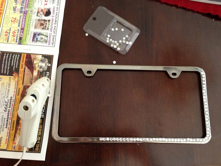 Rhinestone a plain license plate frame. All you need are rhinestones and a hot glue gun. No need to pay $20 for one!