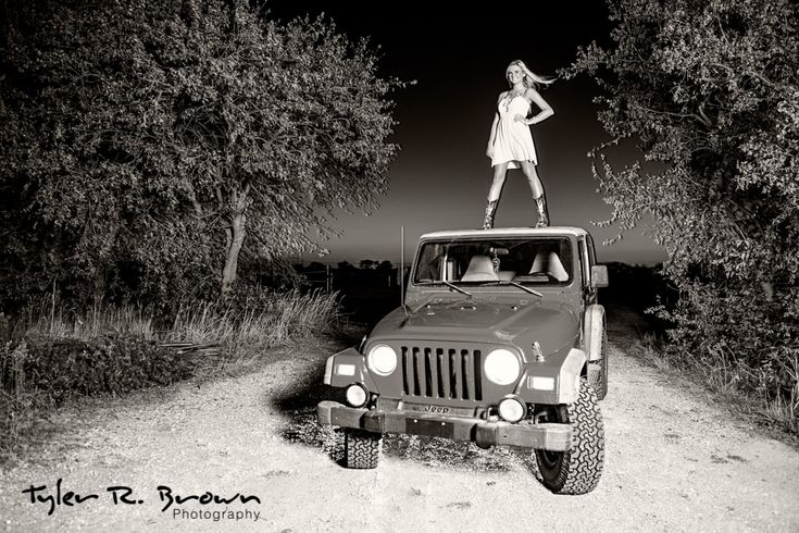 Heritage High School cheerleader, Maddie, stands on top of her Jeep in this awesome black and white portrait.