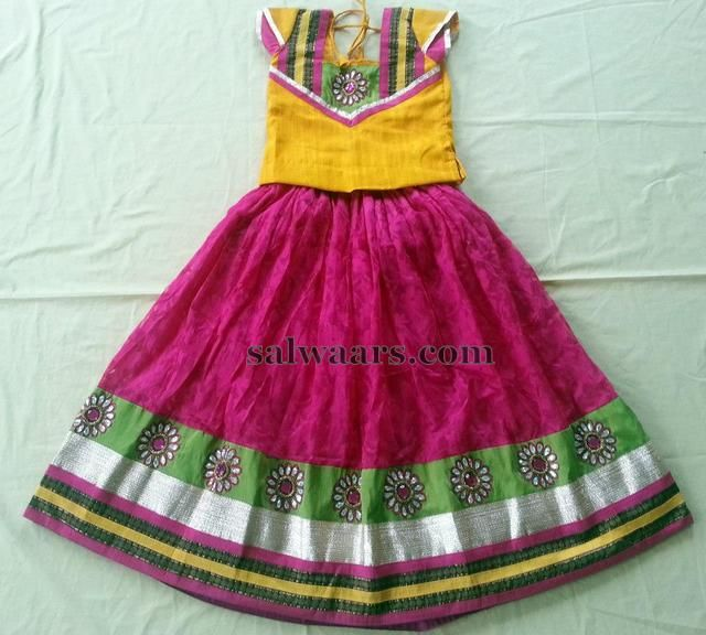 Bright pink tissue kids designer lehenga teamed up with green, silver and pink…
