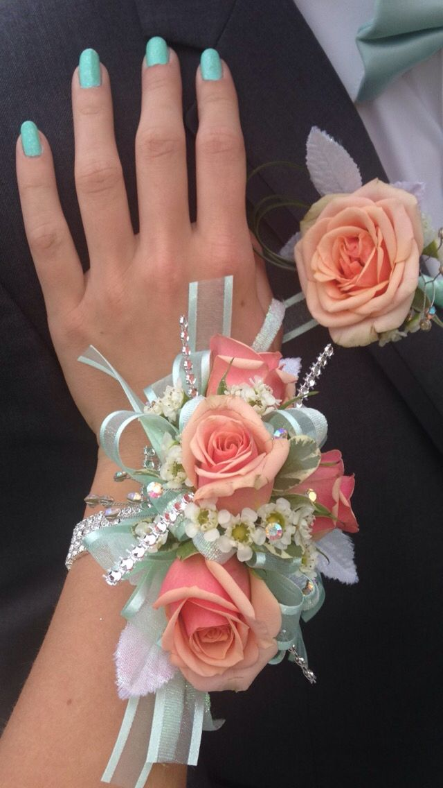 Beautiful corsage and matching coral and mint boutonniere..exactly what I wanted for prom with my dress