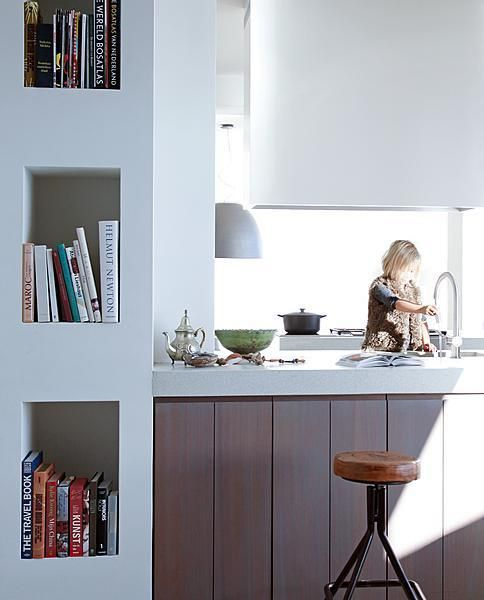Boeken in de nis | vtwonen; Clever use of a column... Might incorporate into my kitchen.