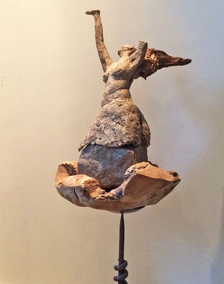 Wind beneath my wing, ceramic patinated, wood, stone 60 x 41 x 29 cm