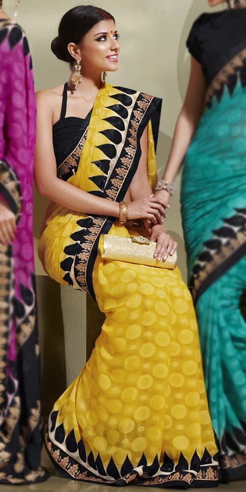 yellow sari with black halter neck blouse. Very nice